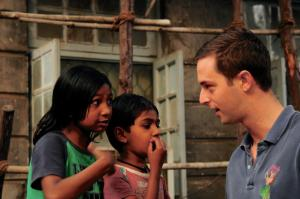 Andrew Gordon, CBS '13 , meeting curious children in the streets of Mumbai.
