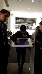 Showing us how to digitally reserve a seat at the Samsung Library at Yonsei University