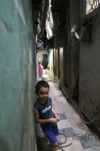 Boy in a narrow street in Dharavi