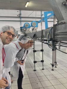 Douglas Kurdziel '14, Tyler Bolender '14 and Jackie Martinez '14 inspect the line at the Coke bottling plant