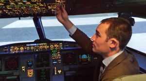 Tyler Bolender '14 takes a turn in the flight simulator
