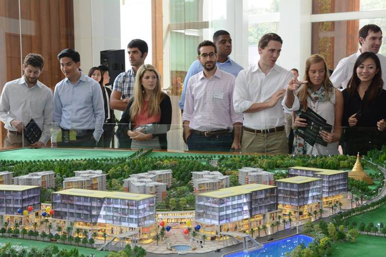 CBS students admiring the detailed Dagon City 1 project model